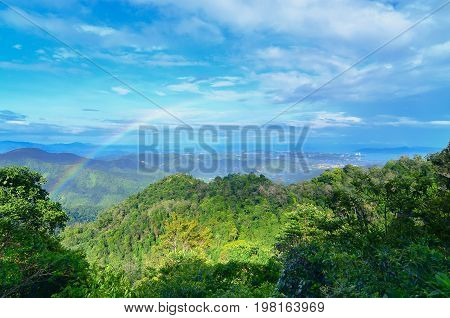 Borneo jungle and mountains landscape view with rainbow in Kokol hill,Inanam,Sabah,Borneo,Malaysia.