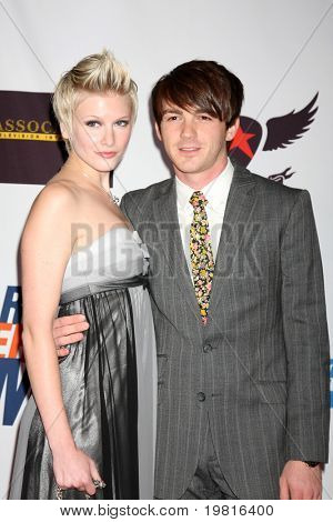 LOS ANGELES - APR 29:  Paydin Lopachin and Drake Bell arriving at the 18th Race to Erase MS Event at Century Plaza Hotel on April 29, 2011 in Century City, CA