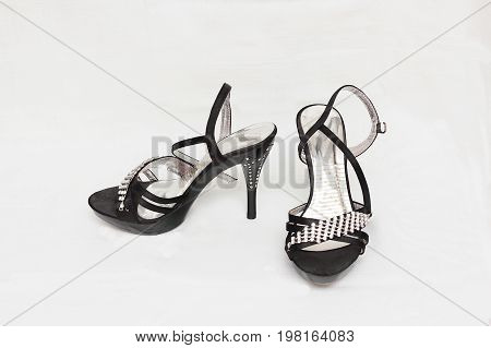 Women's shoes sandals in heels black color isolated white background.