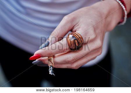 Marijuana Spliff In Woman Hand