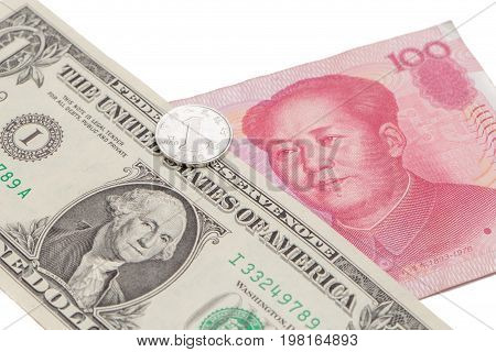 US dollar bill with Chinese yuan banknote and coin on white background USA and Chinese exchange rate concept.