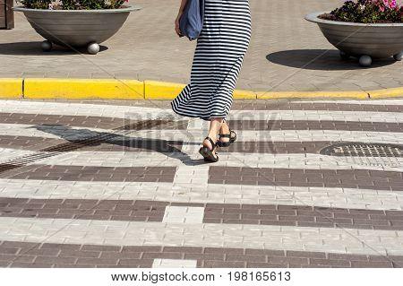 Shapely Woman Walking Trough Crossroad 01