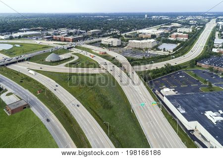 Aerial view of a highways, overpasses and ramps in a suburban Chicago suburban setting.