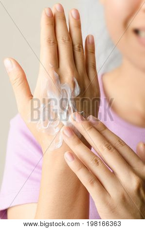 Woman hand with moisture lotion for hand and nail care
