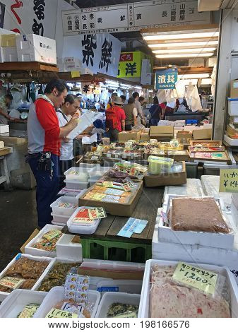 TOKYO JAPAN - JULY 15 2017: Tsukiji Fish Market is one of largest wholesale fish and seafood markets in the world and a popular tourist spot.