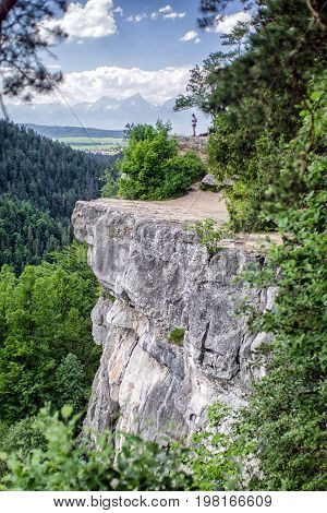 Beautiful viewpoint Tomasovsky vyhlad in Slovak Paradise national park. Hiker on the rock