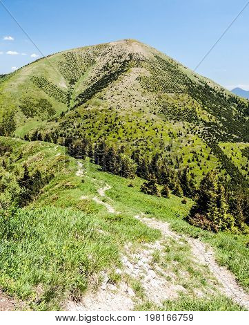 view to Stoh hill from Poludnovy grun hill in Krivanska Mala Fatra mountains in Slovakia during nice day with blue sky and only few small clouds
