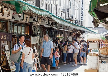 TOKYO JAPAN - JULY 15 2017: Tsukiji Fish Market is one of largest wholesale fish and seafood markets in the world and a popular tourist spot. Tsukiji restaurants outside the market building.
