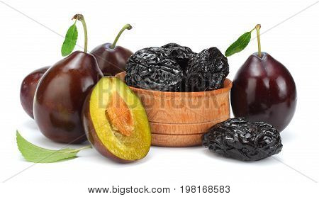 raw fresh plum with prunes in wooden bowl isolated on white background