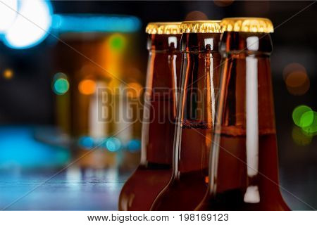 Row bottles beer bar color background festive