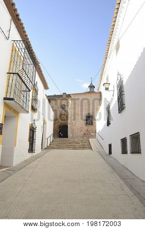Church at the end of white street in Belmonte a village located in the province of Cuenca Castile-La Mancha Spain.