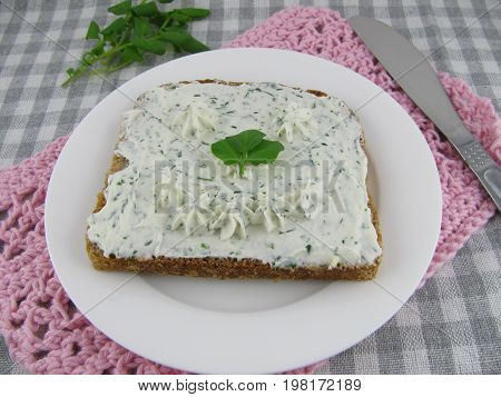 Slice of bread with watercress cream cheese