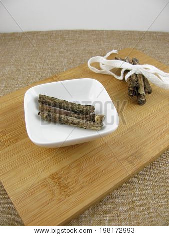 Fresh liquorice sticks on a wooden board