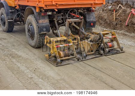 Truck Compacting Gravel At Road Construction Site