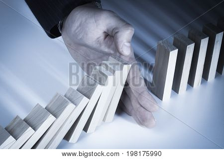 Wooden hand bricks stopping design business person