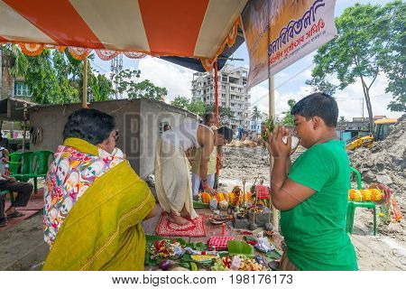 HOWRAH WEST BANGALINDIA - JULY 7TH 2017 : khutipuja the starting ritual of world famous Durga Puja (most famous festival of Hinduism) is being performed by a Hindu Priest amongst Hindu devotees.