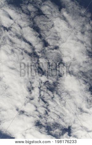 Cloud formation over clear blue sky for a background