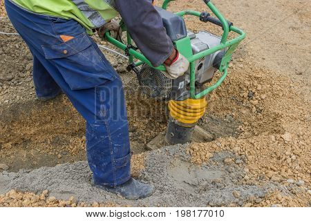 Worker With Trench Rammer