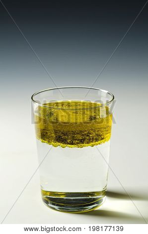 Physics. Immiscible fluids. Oil floating on water.4 of 4 image series.