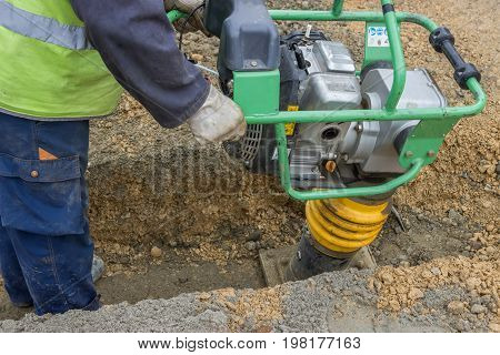 Worker With Trench Rammer 2