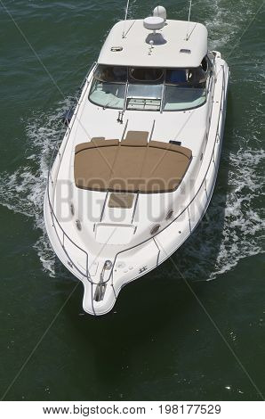 Angled overhead view of an upscale cabin cruiser on the florida intra-coastal waterway off Miami Beach