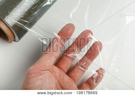wrapping plastic transparent food film on white background.