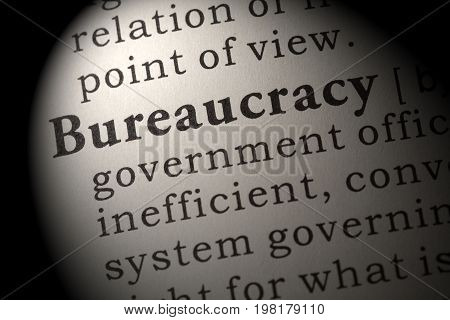 Fake Dictionary Dictionary definition of the word bureaucracy. including key descriptive words.