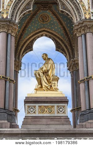 Prince Albert Memorial golden statue Kensington Gardens sculpture at the base of the monument London United Kingdom. It was commissioned by Queen Victoria in memory of her husband opened in July 1872