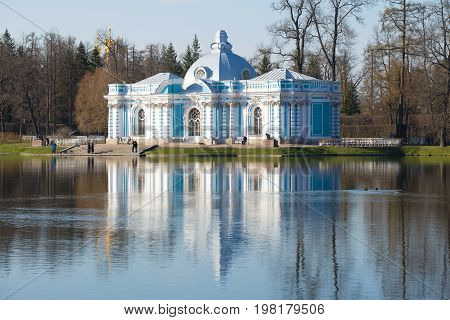 ST PETERSBURG, RUSSIA - MAY 04, 2017: Grotto Pavilion on the Great Pond in the Catherine Park of Tsarskoye Selo in the spring