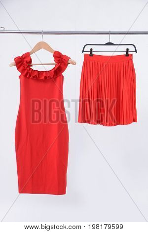 Red flared skirt , sundress on clothes rack isolated