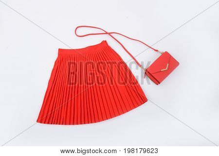 Red pleated skirt with handbag isolated