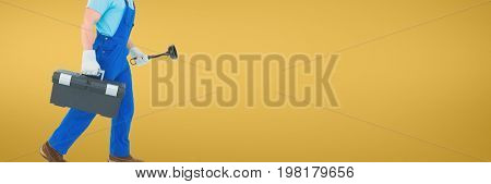 Digital composite of Plumber man holding a plunger and a toolbox against yellow background