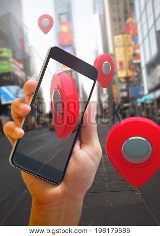 Digital composite of Holding phone and Location pointer markers in city street