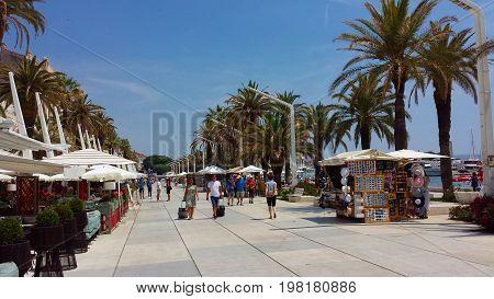 Split, Croatia - June 23, 2017: People on the promenade in Split on a sunny day - Splitska Riva, Croatia