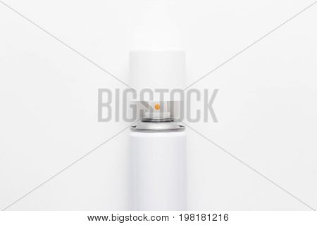 white opened spray can. top view spray can on white background. white opened spray can not isolated. plastic spray can ready for use on the table
