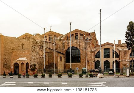 Rome Italy march 18 2017: People walking near the Basilica of Santa Maria degli Angeli e dei Martiri (Basilica of St. Mary of the Angels and the Martyrs) in Rome Italy