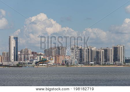 Panoramic view amusement park and aquapark of the river and the city of kazan in sunny day kazan russia