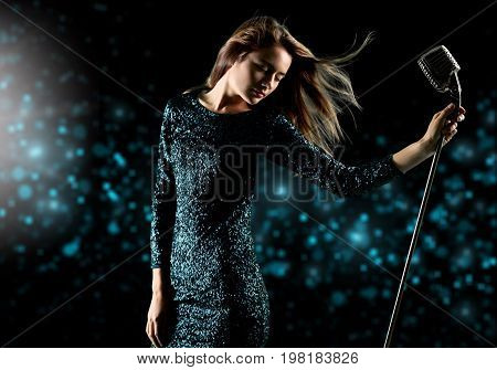 Female young sing microphone singer young adult blue
