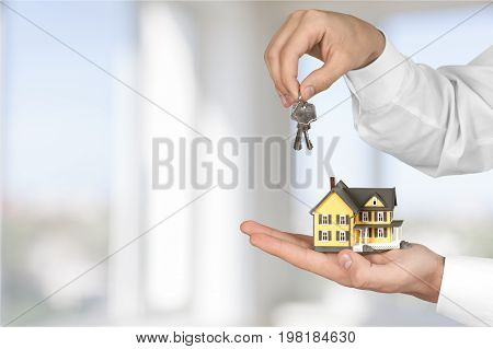 Key holding model hands house man face color
