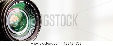 Camera lens with lense reflections on white background.