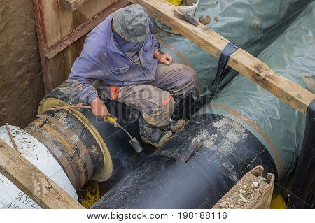 Insulation Worker Applied Tar Coating On Underground Heating Pipe 2