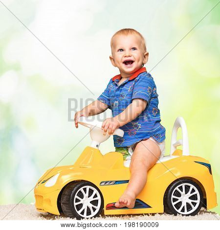 Yellow cute boy toy car elementary age view