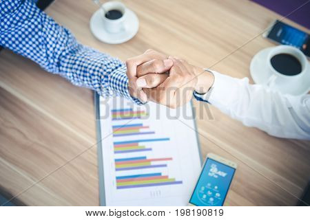 Top View Two Businessman Shaking Hands or Arm Wrestling cooperative and teamwork conceptcorporate life styleCooperation initiative achievement