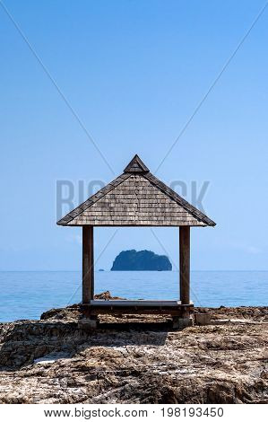 Arbor on the shore of the island of Maiton,Thailand, on a sunny day. Another island in the background