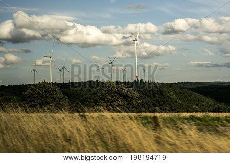 Wind energy generator Windmills cloudy sky in Germany Eifel