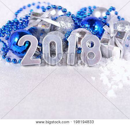 2018 Year Silver Figures And Silvery And Blue Christmas Decorations