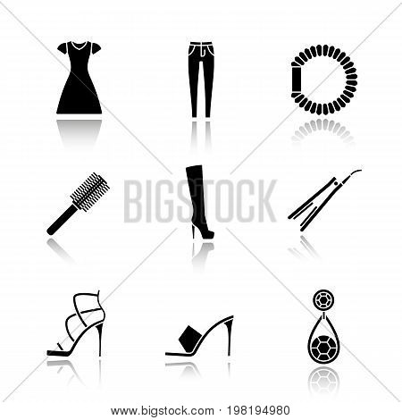Women's accessories drop shadow black glyph icons set. Sun frock, skinny jeans, hair scrunchy, straightener and brush, high heel boot and shoes, earring. Isolated vector illustrations