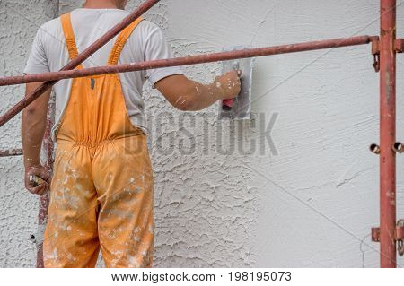 Plasterer Applying A Finish Coating To A Wall 3