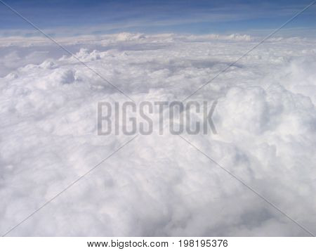 VIEW OF CLOUDS STRETCHING FROM THE FORE GROUND TO THE BACK  GROUND
