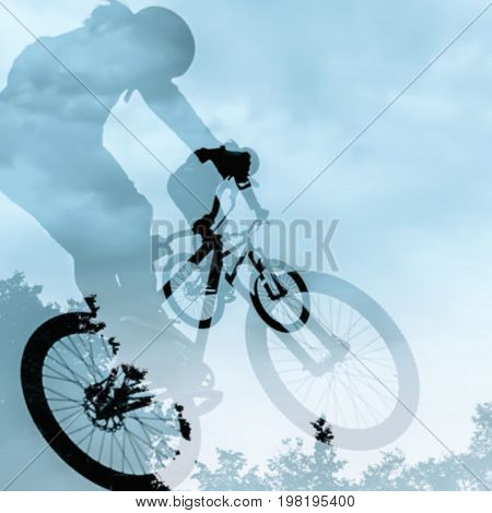 Close-up of double silhouette of unidentified young man doing a jump with a bmx bike against blue sky. Extrem Sport and risk